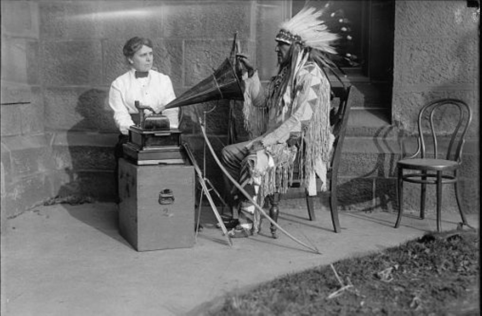 Mountain-Chief-of-Montana-Blackfeet-listening-to-phonograph-with-ethnologist-Frances-Densmore
